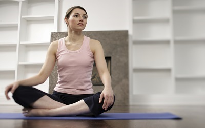 What precautions should I keep in mind while practicing yoga during pregnancy?